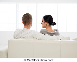 couple happy with purchase of new house