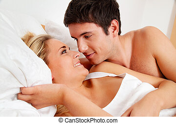 couple has fun in bed