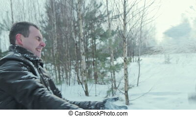 Couple have fun and kissing in winter forest