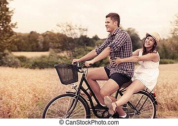 Couple have fun riding on bike