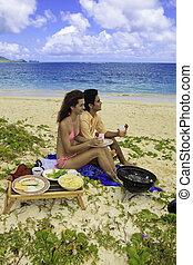 couple having a barbecue on Lanikai beach