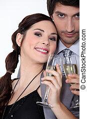 Couple having a celebratory drink