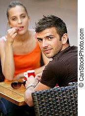 Couple having a coffee on terrace