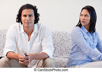 Couple having a dispute in the living room - Young couple...