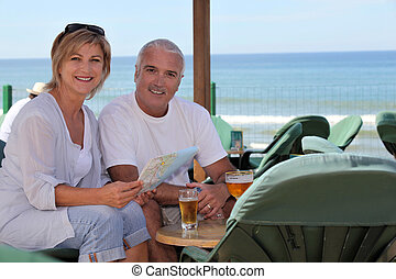 Couple having a drink on holiday