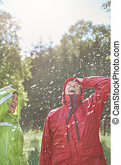 Couple having a fun in wet day