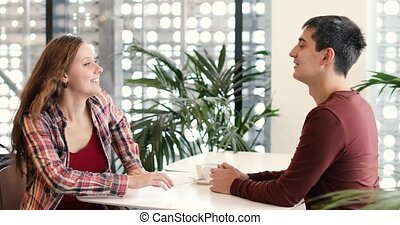 Couple having a good time together coffee