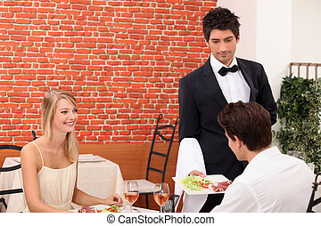 couple having a romantic dinner in a sexy restaurant