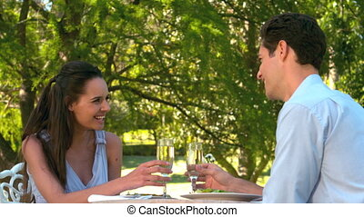 Couple having a romantic meal together outside in slow motion