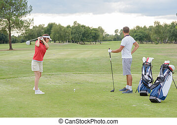 Couple having a round on the golfcourse