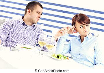 Couple having argument in a restaurant