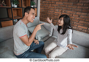 Couple having argument on the couch