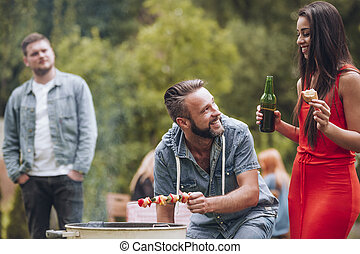 Couple having barbeque