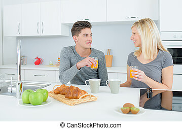 couple having breakfast in kitchen