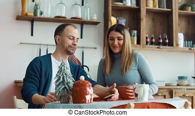 Couple having breakfast together in the kitchen