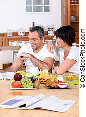 Couple having breakfast together