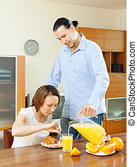 couple having breakfast with juice