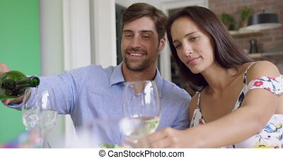 Couple having champagne on dining table at home 4k