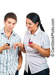 Couple having conversation about phones