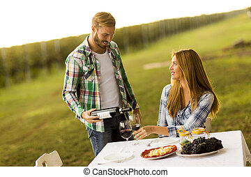 Couple having dinner vineyard