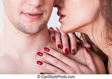 Couple having erotic moment - Horizontal view of couple...