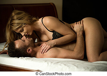 Couple having erotic moments - Young couple having erotic...