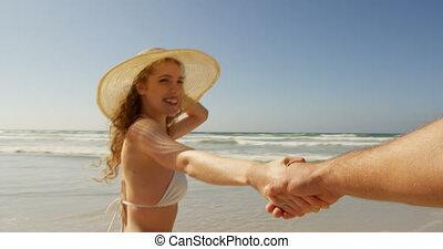 Couple having fun at beach on a sunny day 4k