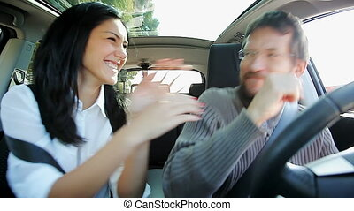 Couple having fun dancing in car