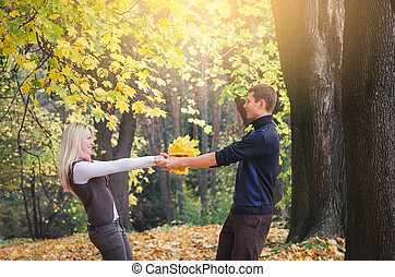 Couple having fun in autumn park