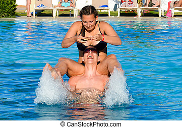 Couple having fun in the pool
