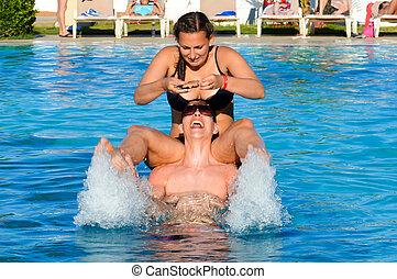 Couple having fun in the pool