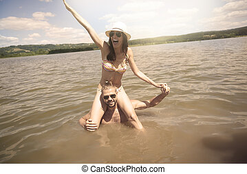Couple having fun in the water