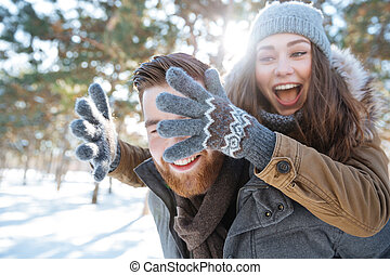 Couple having fun in winter park