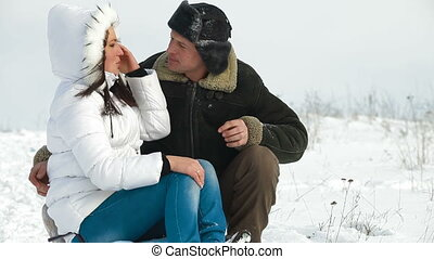 Couple Having Fun on a Sled