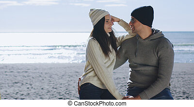 Couple having fun on beautiful autumn day at beach