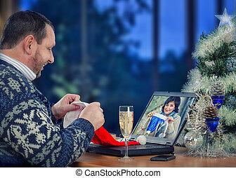 Couple having fun on Christmas Eve