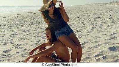 Couple having fun on the beach 4k