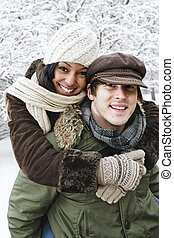 Couple having fun outside in winter - Portrait of couple...