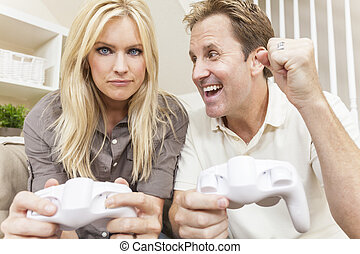 Couple Having Fun Playing Video Console Game - Couple, man...