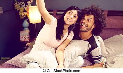 Couple having fun taking selfie