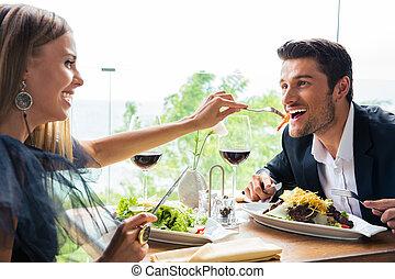 Couple having lunch in restaurant - Funny couple having...