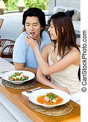 Couple Having Lunch - A young Asian couple enjoying lunch...