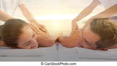 Couple having massage at spa and sea landscape for valentine day 4k