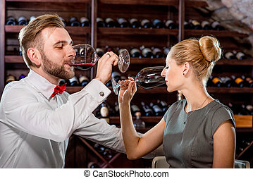 Couple having romantic wine tasting at the cellar - Romantic...