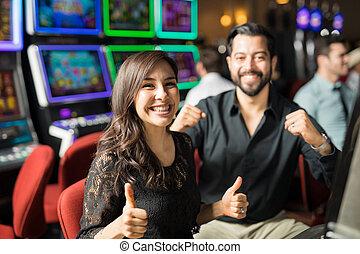 Couple having some fun in a casino