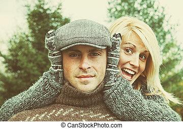 Couple having some fun on a autumn day