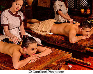 Couple having stone massage.