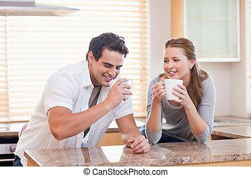 Couple having tea in the kitchen