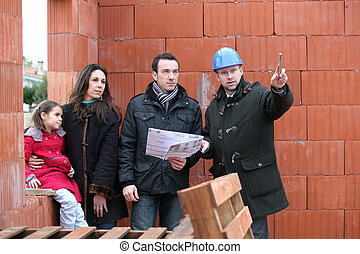 Couple having their new home inspected by an engineer