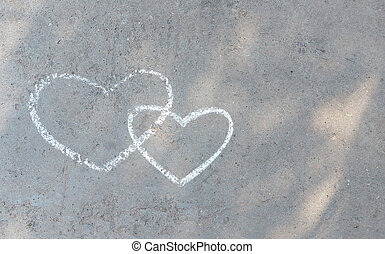 couple heart drawn with chalk on the asphalt. love confession. banner place for text, valentine, children creativity copy space, summer
